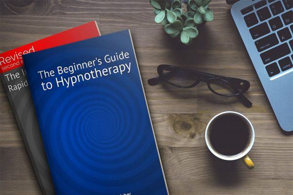 The beginner's guide to hypnotherapy book on a coffee table