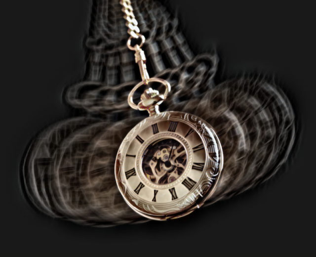 A pendulum swinging, which is a part of the chevreul's pendulum hypnotic suggestibility test