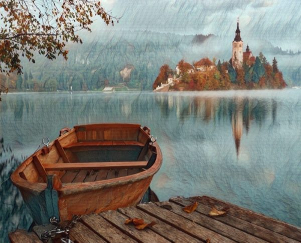 An example of a hypnotherapy metaphor image, with a boat moored at a pier, with a fairytale lake and castle in the background.