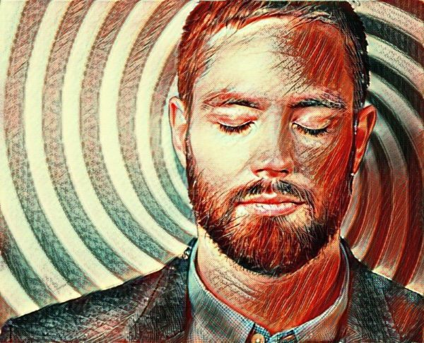 A man in self-hypnosis with his eyes closed and a spiral background behind him