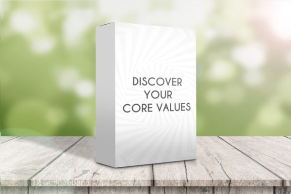 A pack of Core Values Cards sat on a wooden table with an out of focus background