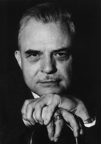 A headshot of Milton H Erickson, the father of modern hypnotherapy