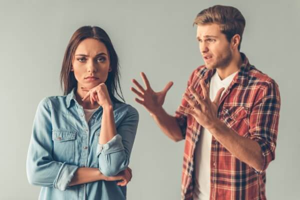 Man complaining to woman, using his cognitive distortion, fallacy of change. Woman not looking impressed.